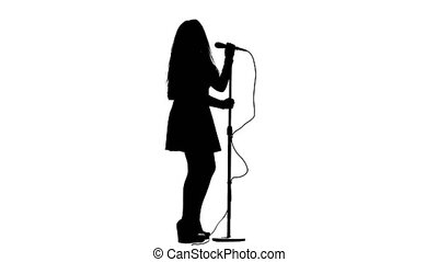 Singer dances to the beat of her song. White background....