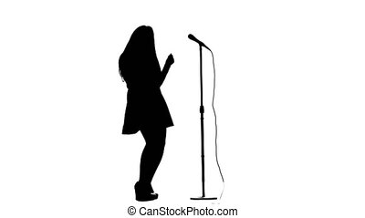 Singer dances to the beat of her song. White background. Silhouette. Side view. Slow motion