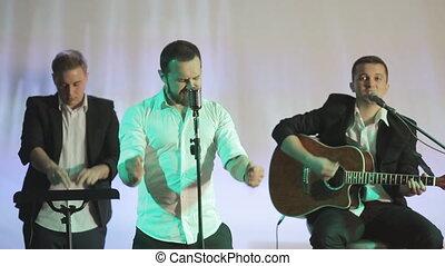 Singer, guitarist and dj performing in karaoke