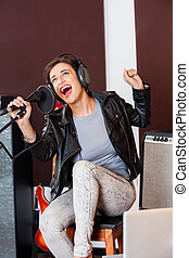 Singer Having Fun While Singing In Recording Studio