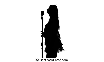 Singer holds the microphone. White. Silhouette