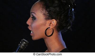 Singer in profile.