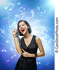 Singer keeping mike against blue music background with notes