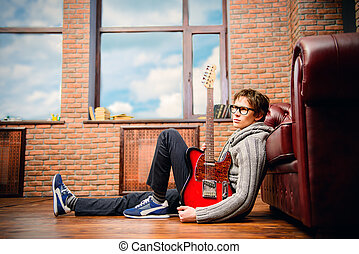 singer on a floor - Handsome young man musician playing his...