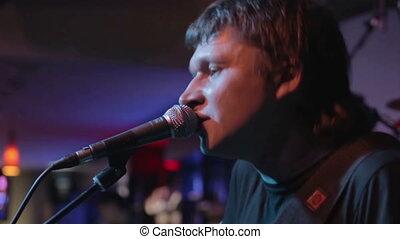 Singer performs a club closeup