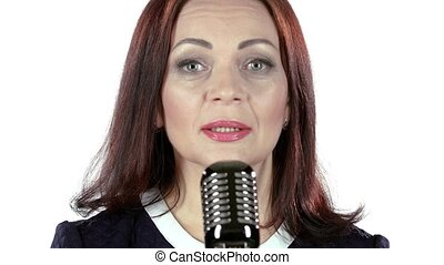 Singer performs her song of authorship. White background -...