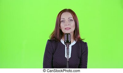 Singer performs her song of authorship. Green screen -...
