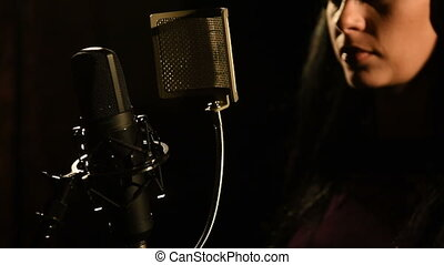 Singer recording a song in music studio