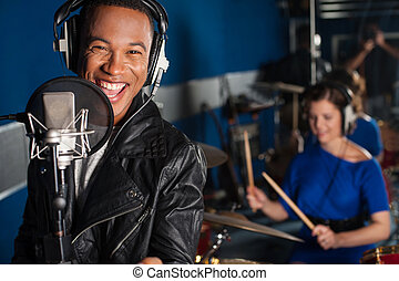 Singer recording a song in studio