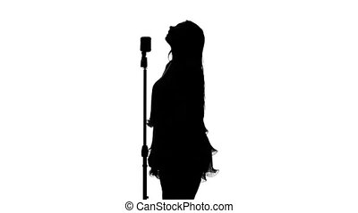 Singer singing in front of a retro microphone. White. Silhouette