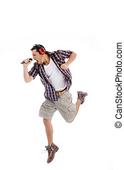 singer singing loudly in to microphone on an isolated...