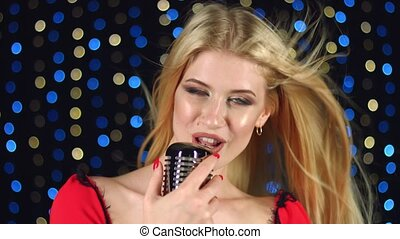 Singer sings into the microphone - Singer sings in a retro...