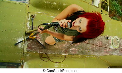 Singer with fiery hair - Beautiful girl with multicolored...