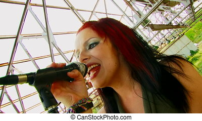 Singer with red hair - Beautiful girl with multicolored...