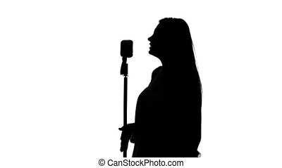 Singer with retro microphone. White. Silhouette