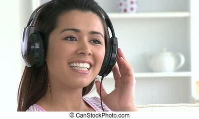 Singing asian woman listen to music