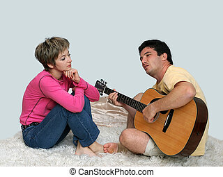 Singing for love - Man playing guitar for his girl