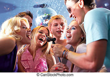 Singing friends - Portrait of joyous guys and girls singing ...