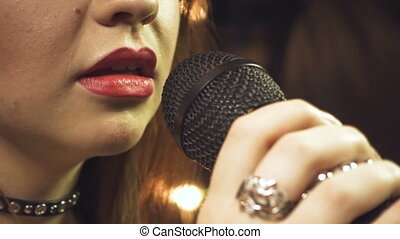 Singing girl with red lips