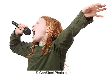 Singing girl - Young red haired girl singing into microphone...