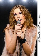 singing glam rock song
