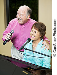 Singing Senior Couple - Senior couple performs. They both...