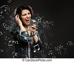 Singing song rock musician with mic and earphones
