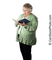 Singing Surprise - A senior woman singing from a songbook...