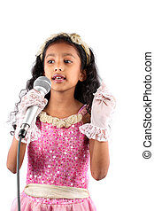 Singing Talent - A little Indian girl singing with a mic, on...