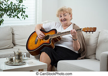 Elderly cheerful woman singing the song
