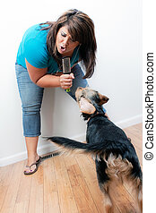 Singing to the Dog - A Hispanic woman singing on a pretend ...