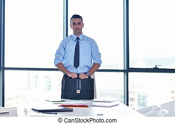 business man waiting for meeting to begin in Board room