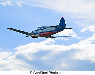 Single aeroplane flying in blue sky  through the clouds