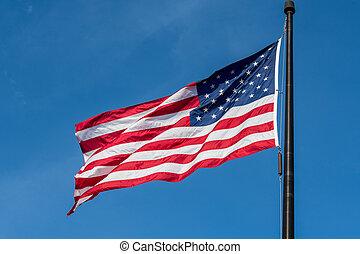 Single American Flag on Blue Sky