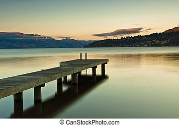 single boat dock on mountain lake