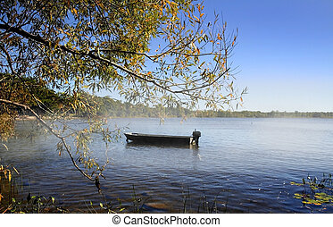 Single Boat On The Lake