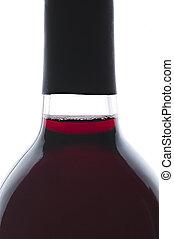 Single bottle of backlit red wine