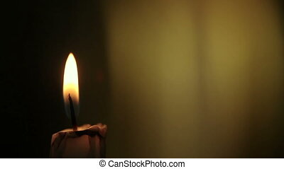 Candle lights up and being blown out slowly