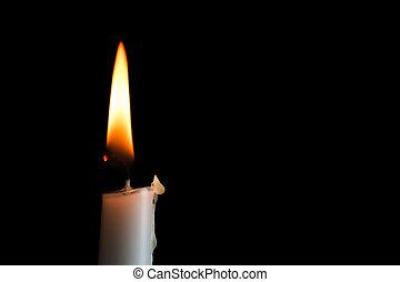 Single Candle Left - A single white candle burns shining ...