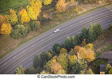 Single Car Driving Around Bend