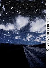 Single car travels on dark road