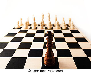 Single chess piece the King standing up against many of his ...