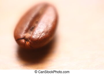 Single coffee bean with high magnification and soft focus...