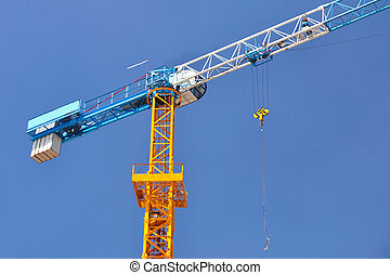 Single crane in construction-area with blue-sky.