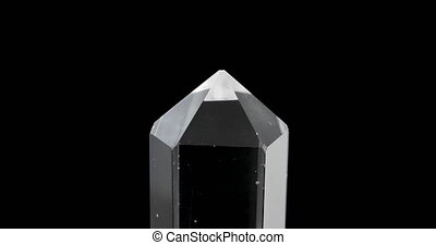 Single crystal quartz on a black background. Loop. UltraHD...