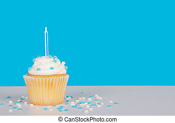 Single cupcake with blue candle and sprinkles - Single...