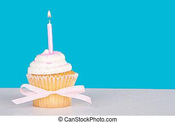 Single cupcake with lit pink candle - Single vanilla cupcake...