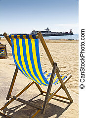 Single deck chair on the beach at Bournemouth, Dorset,UK...