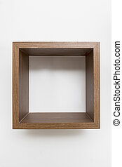 Single empty square shape shelf on white