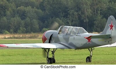 Single engine airplane on a grass runway.